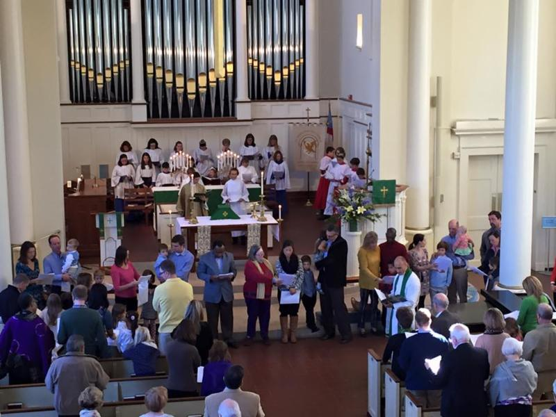 Parishioners and clergy at the Liturgy of Welcome