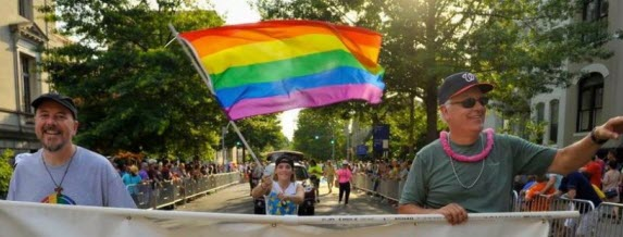 St. John's parishioners marching in the Pride Parade with a rainbow flag