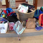 Backpacks on the altar to be blessed