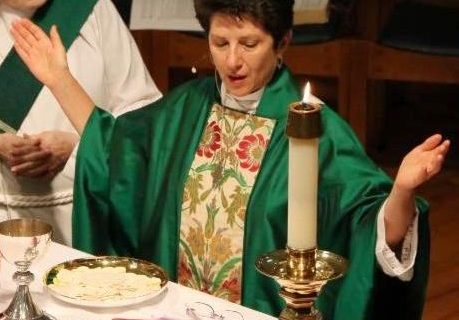 Kate Heichler celebrating the eucharist