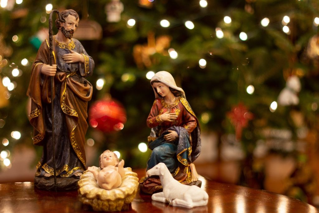 Nativity scene in front of Christmas tree