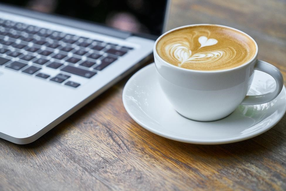 A Latte next to a laptop