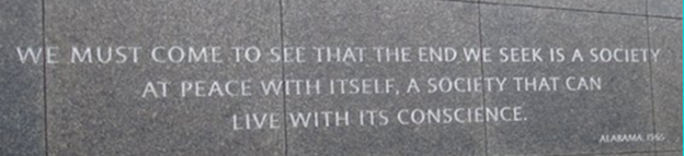 """A quote on a monument, """"We must come to see that the end we seek is a society at peace with itself, a society that can live with its conscience."""""""