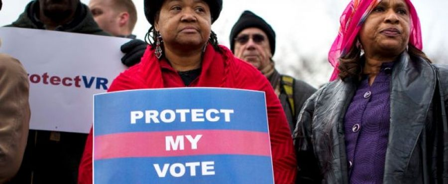 "Black women carrying signs reading ""Protect My Vote"""